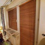 Żaluzje drewniane - okno i balkon